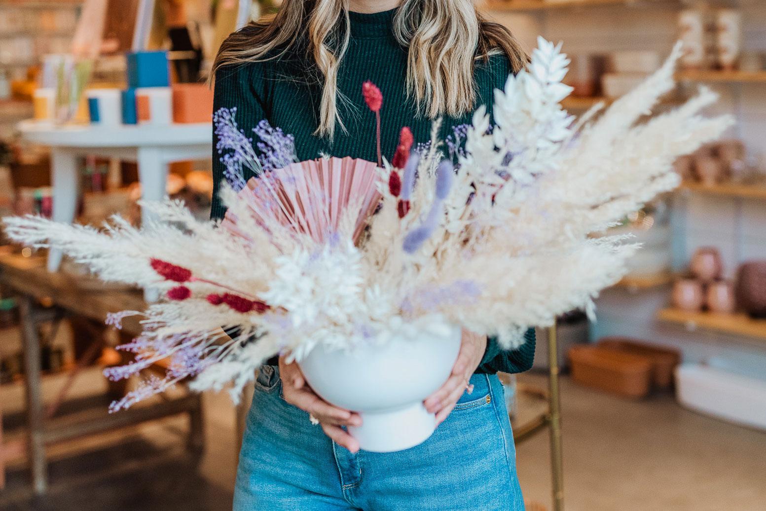 Woman holding vase.